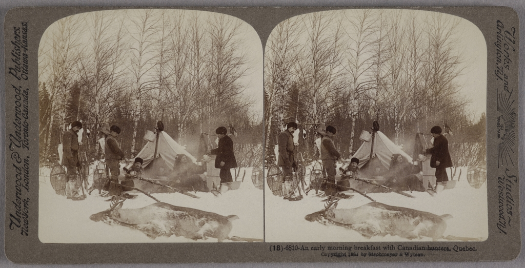 Campement hivernal de chasseurs en train de se servir le thé